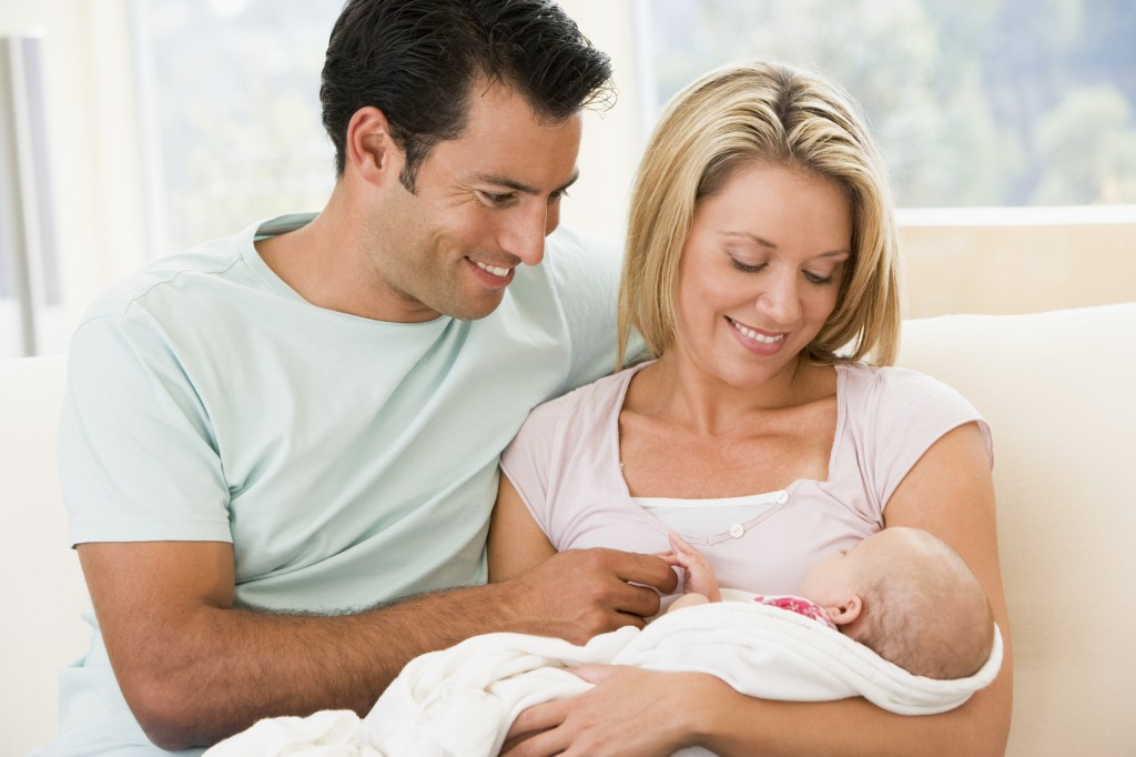 Couple in living room with baby