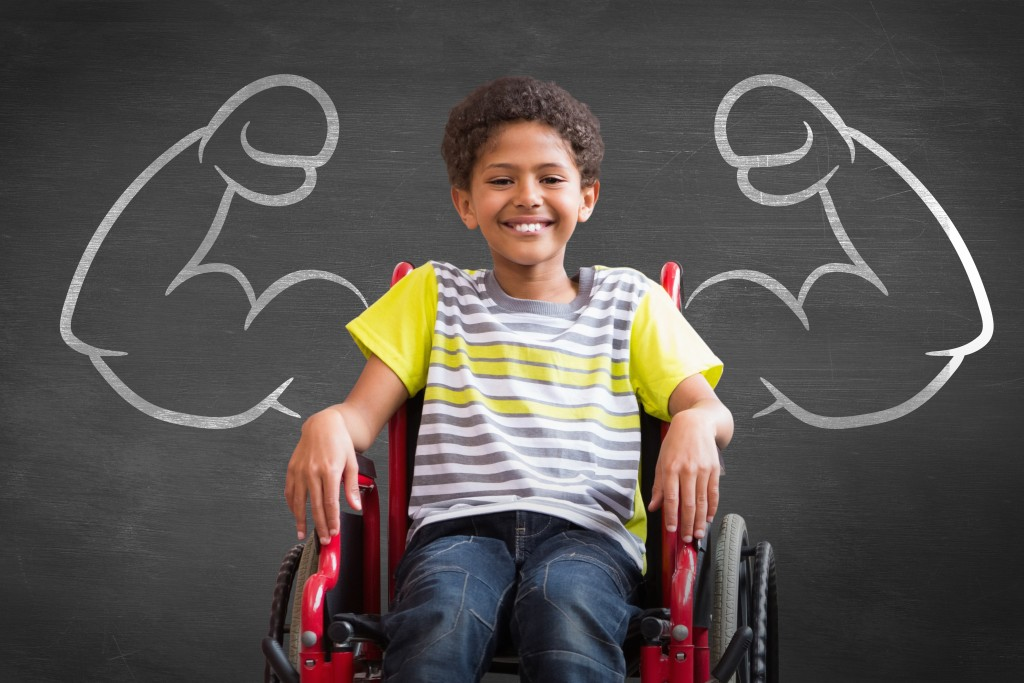 Composite image of cute disabled pupil